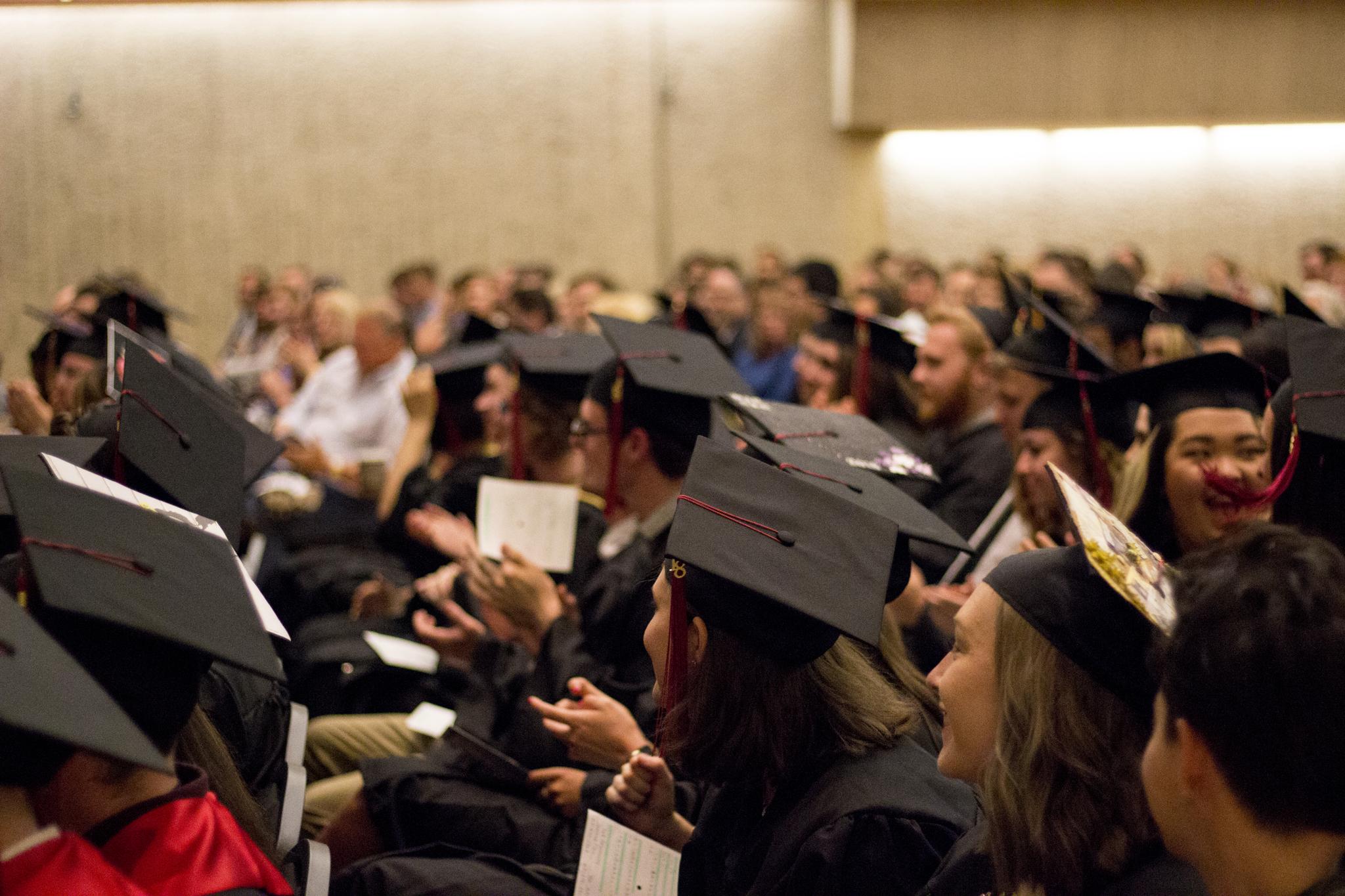 Students clapping at graduation