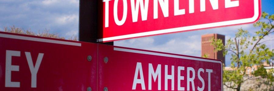 Town line sign designating Hadley Amherst border