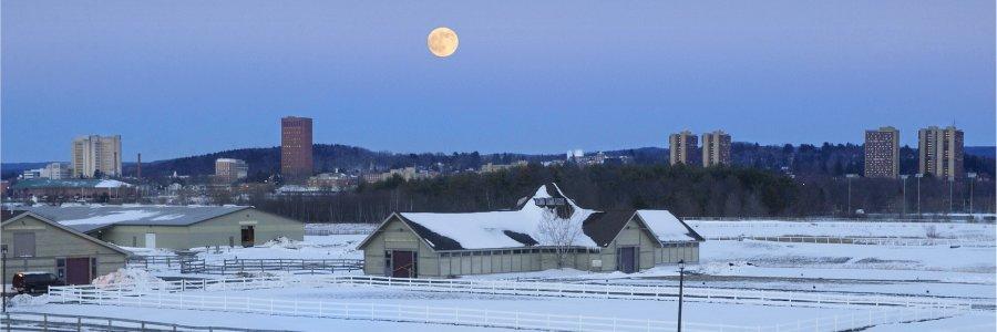 UMass skyline and farms under a full moon