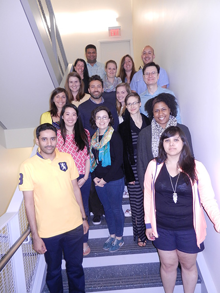 The 2015 Analyzing Intensive Longitudinal Data class congregates in the stairwell of UMass Amherst's Integrative Learning Center (ILC).