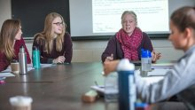 Dr. KC Haydon lectures a class of students at Mount Holyoke College