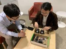 Sunghoon Ivan Lee and Jie Xiong looking over prototype apparatus