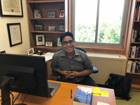 Cedric de Leon at his desk in the UMass Labor Center