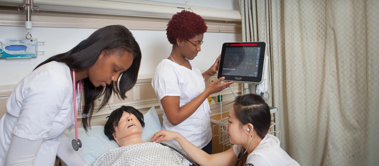 Students working in sim lab.