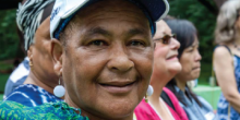 Smiling woman in a hat with colorful outfit