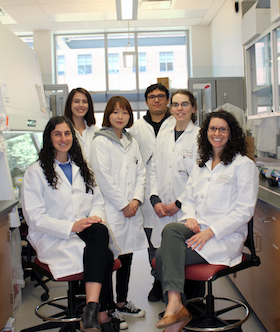 Andrews-Schiffman Team Photo in lab coats