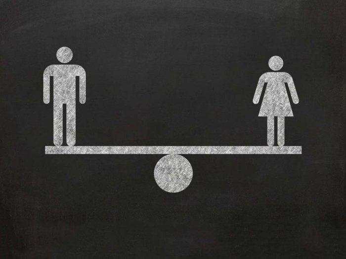 abstract image of a man and woman balancing equally on each side of a scale