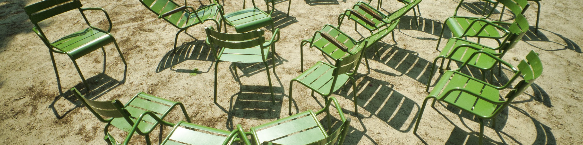 Green metal chairs outside