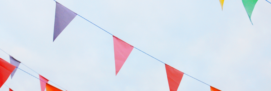 colorful pennant flags against a gray sky