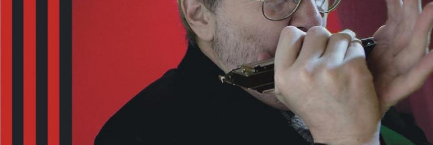 Steve Tracy playing the harmonica