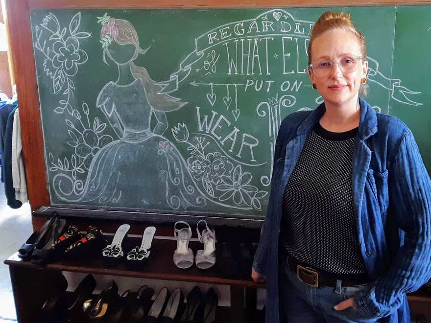 Alice Erickson in front of chalkboard
