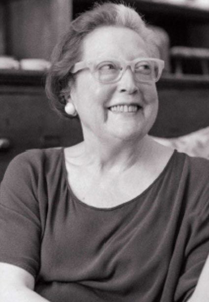 Photo of Artist Martha Wilson smiling, black and white
