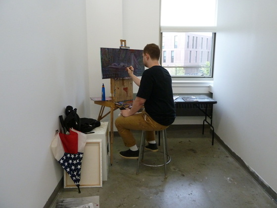 BFA student Matthew Stec, working in his studio in the SAB.