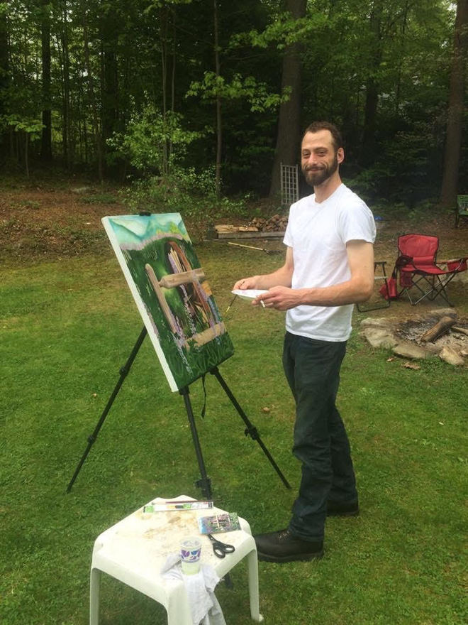 Ryan Jobb paints at an easel