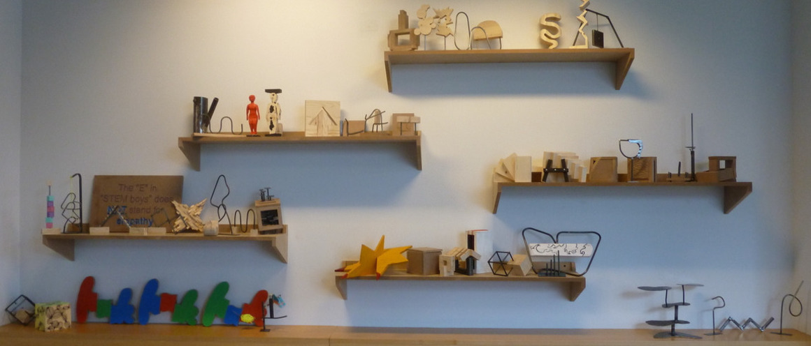 Shelves containing small works of art
