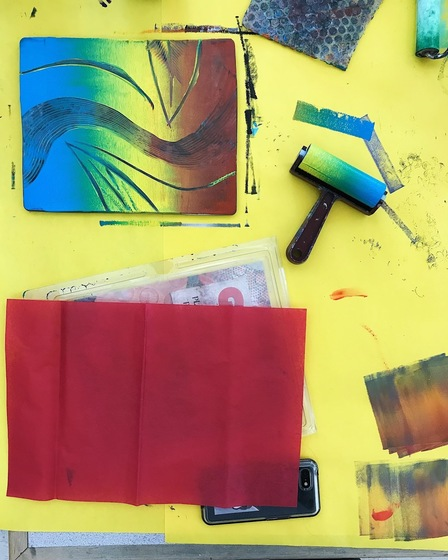 Samples of Tessa Chambers' works in progress against a yellow backdrop