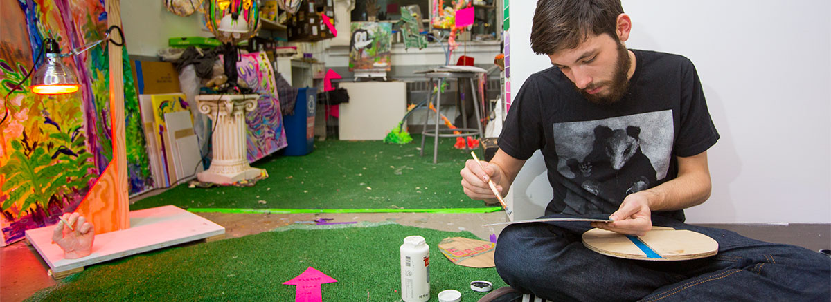 A student works on a project during Open Studio night