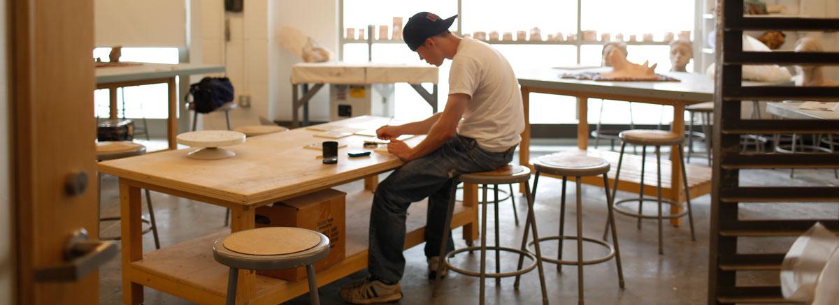 student working in an empty studio