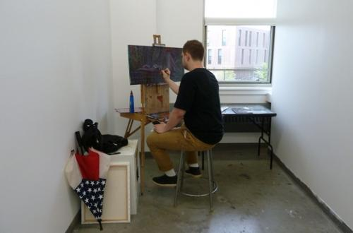 BFA student Matthew Stec, working in his studio in the SAB.