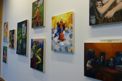 Framed art is displayed on a wall