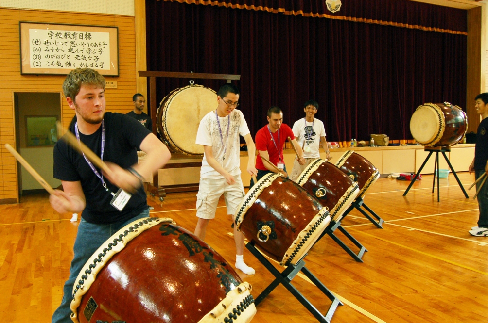 Students playing Japanese style drums