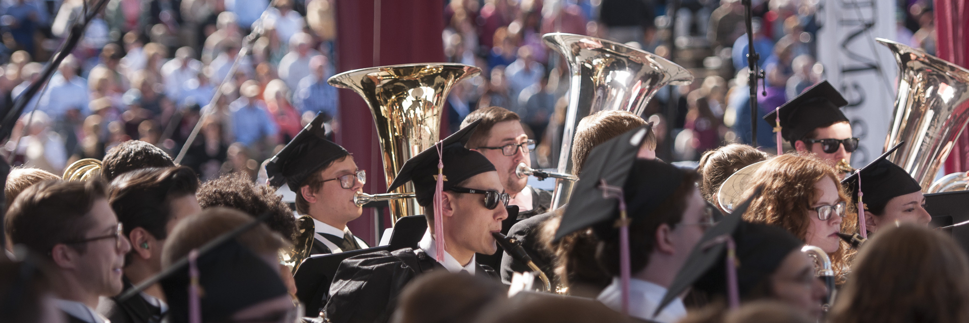 Students playing instruments at UMass Undergraduate Commencement