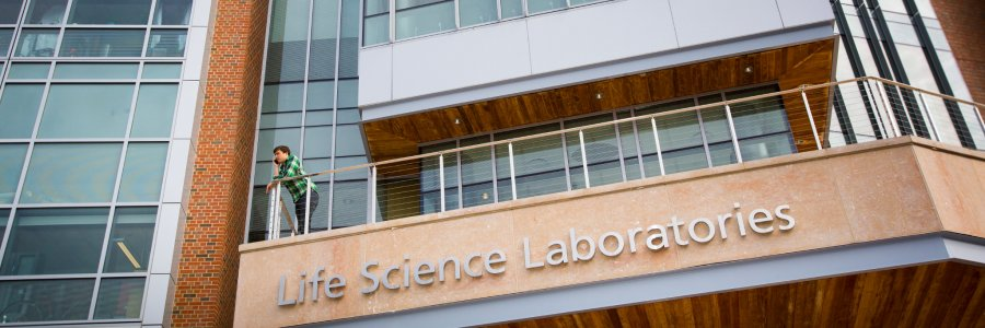 Student on Life Science Lab balcony