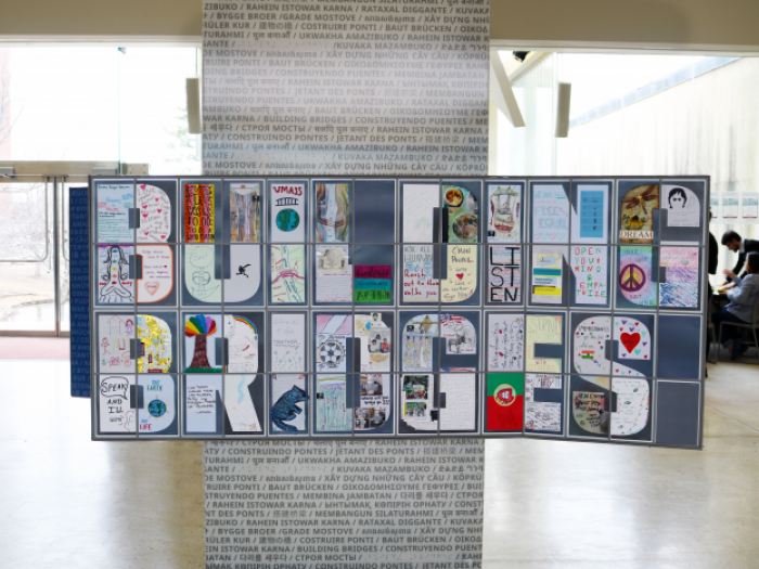 "a mosaic of hand drawn images that form the words ""building bridges"""