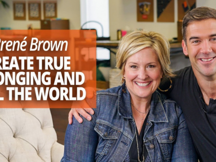 "Brene Brown and Lewis Howes behind text reading ""Create True Belonging and Heal the World"""