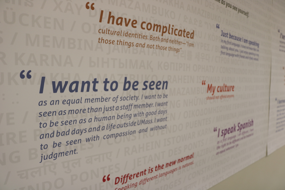 "IMage of wall panels with quote saying ""I want to be seen as an equal member of society. I want to be seen as a human being with good days and bad days and a life outside of umass. I want to be seen with compassion and without judgment."""