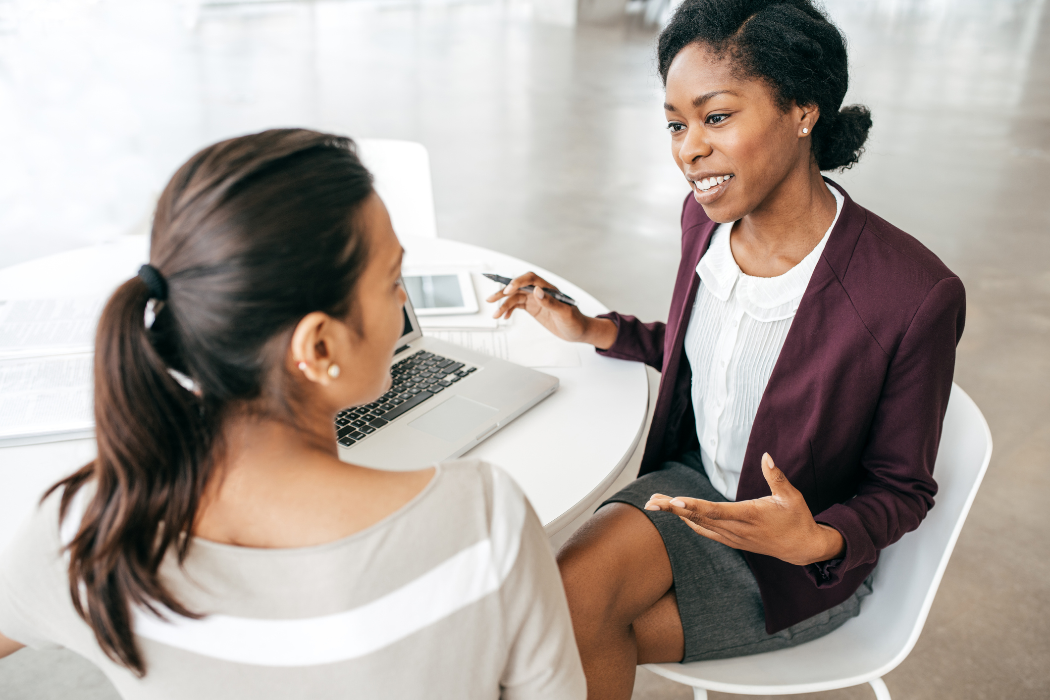 Image of a woman getting mentored