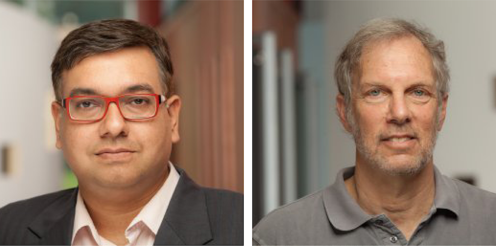 Shouvik Chakraborty, assistant research professor (left), and Robert Pollin, distinguished professor of economics and co-director of PERI