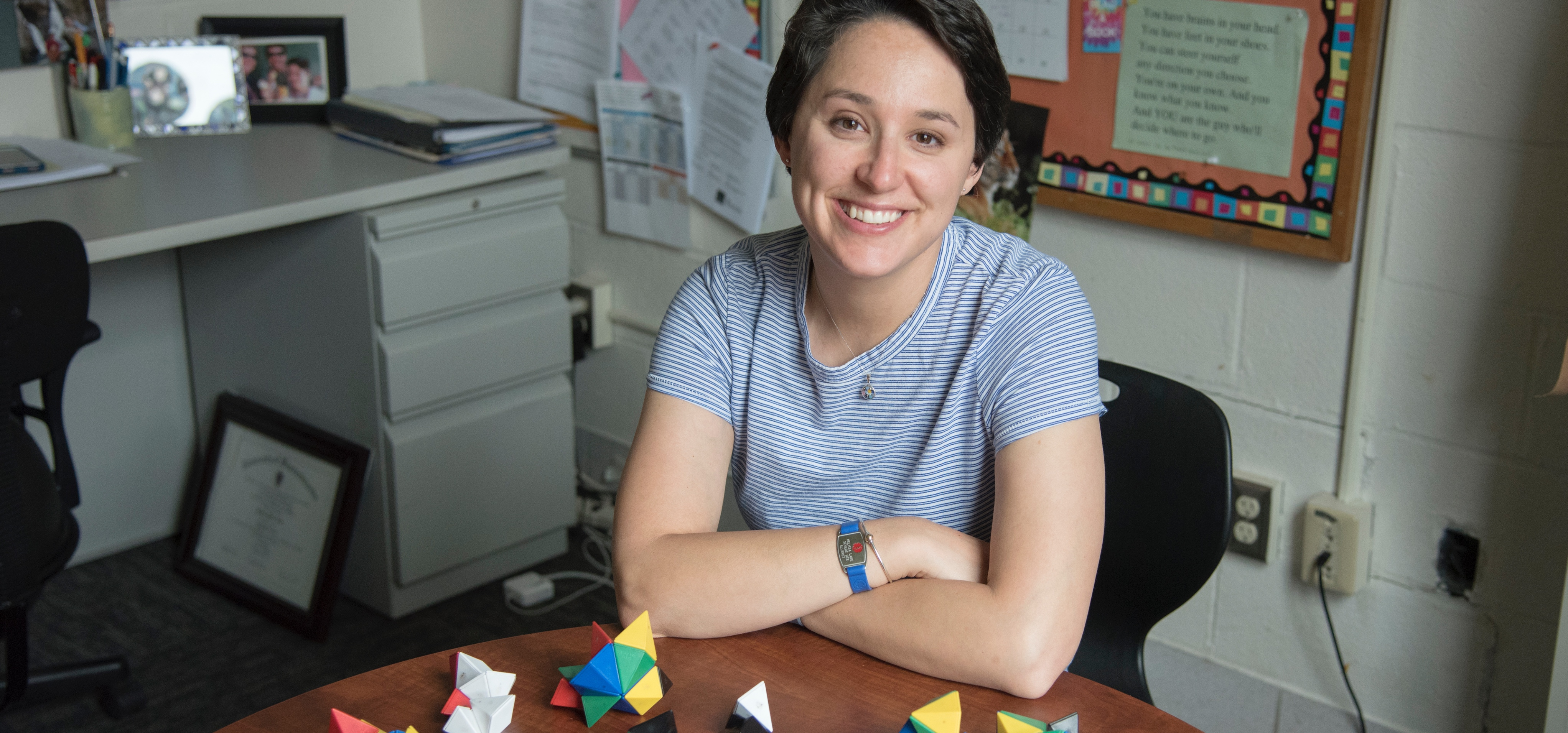 Teacher sitting at table with shape blocks