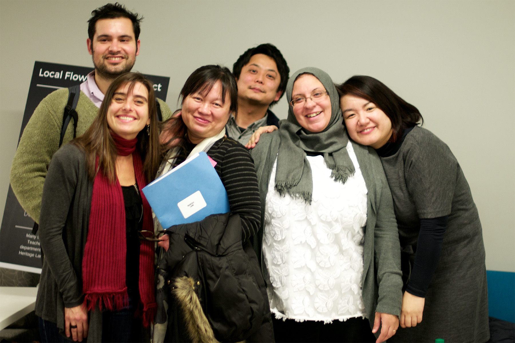 students smiling in group at workshop