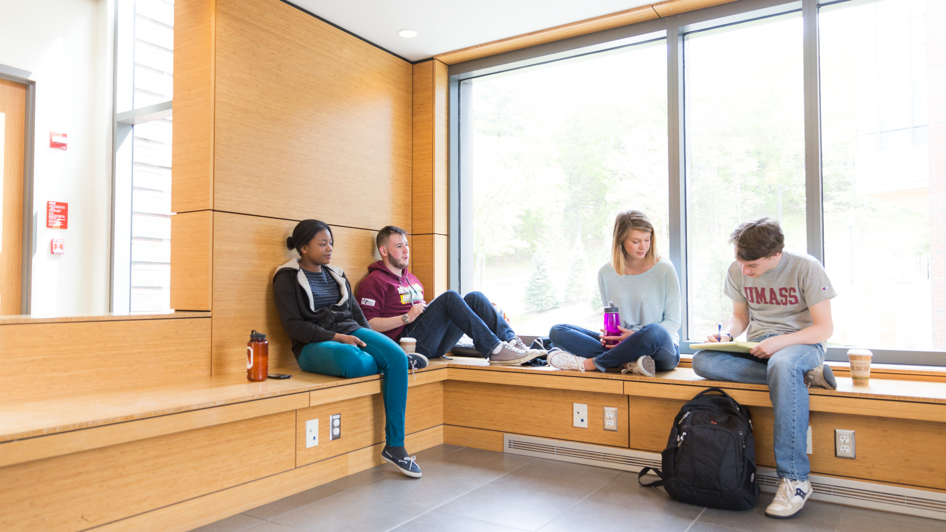 UMass Amherst students study on campus.