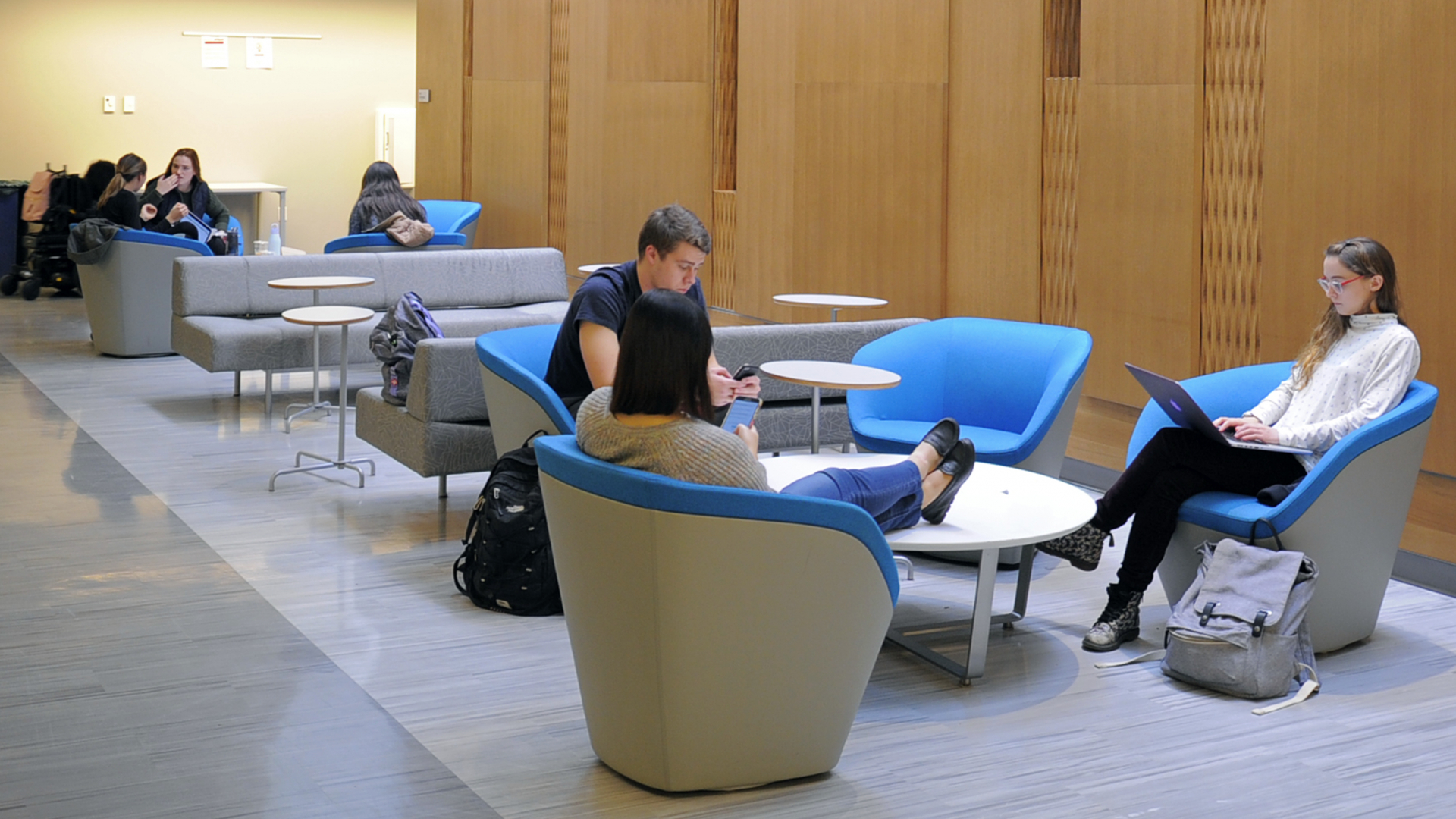 Students in Furcolo Hall seated in common area