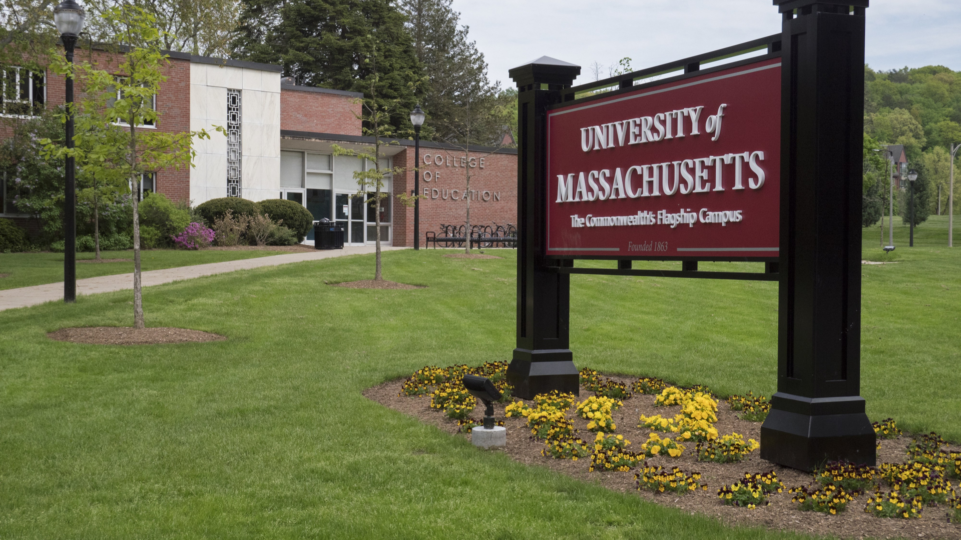 College of Education building with UMass Amherst sign