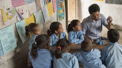 Nepalese children in class with their teacher
