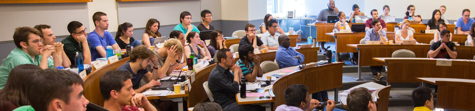 UMAss Amherst students attend a lecture.