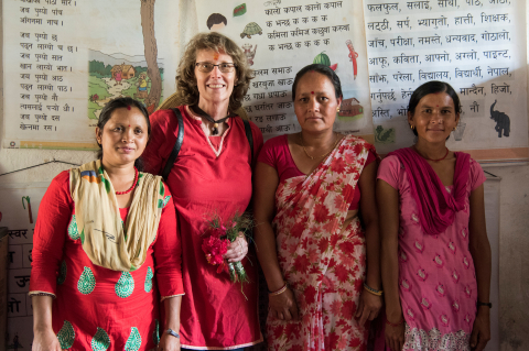 Professor Cristine Smith stands with three Nepali female educators