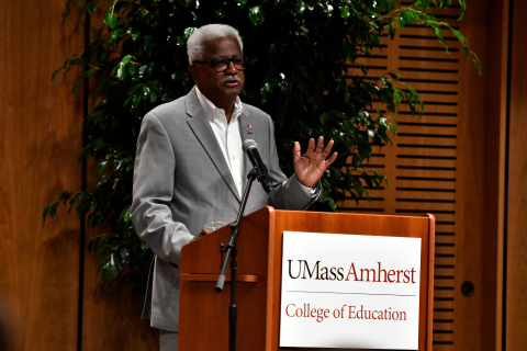 Charles Desmond speaks at the Carney Family Auditorium ribbon cutting ceremony at the UMass College of Ed