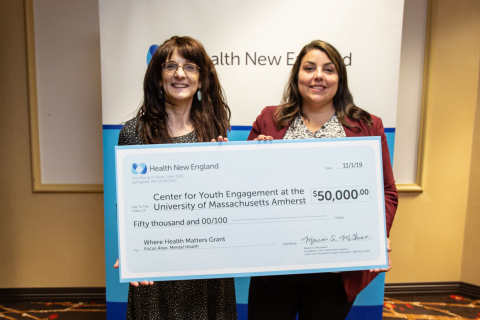 Karen Harrington and Sarah Fefer hold the $50,000 grant check from Health New England