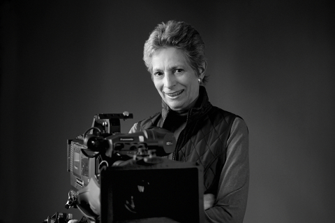 Professor Emerita Liane Brandon with Film Camera