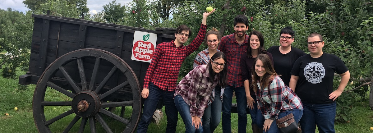 Graduate students in Composition and Rhetoric apple picking
