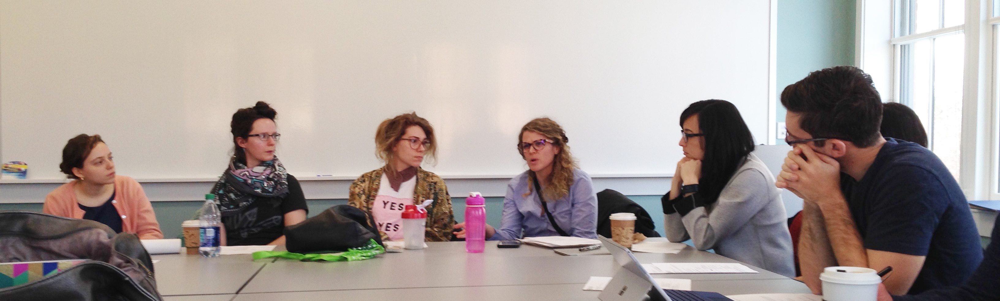 Graduate Students in the Composition and Rhetoric program discuss work in progress at a Comp Share