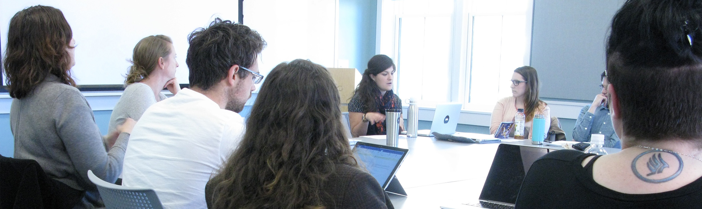 Graduate students and faculty participate in a workshop.