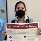 Julia holding Specializations poster