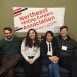 Students in front of the NEWCA conference banner