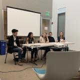 Students presenting on a panel at the State of English Studies Event