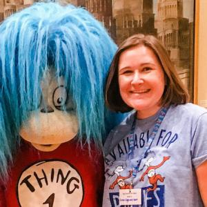 Emily Bevacqua standing with Thing 1 and 2 from Dr. Suess